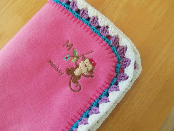 Adorable pink fleece blanket with embroidered monkey and crocheted edge, 32 x 42