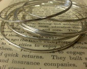 Set of 7 thin, stacking sterling silver bangles