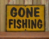 Gone fishing sign made from reclaimed plywood