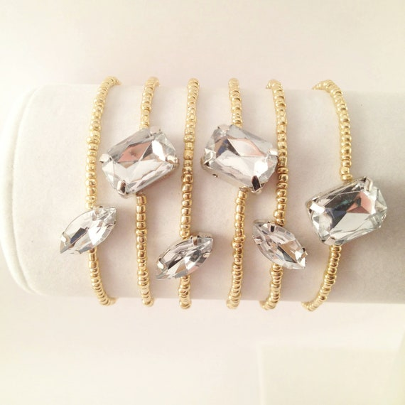 gold beaded bracelet with clear marquise rhinestone