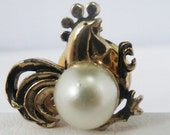 Vintage jewelry tie tack in a Rooster Motif in gold tone with white simulated pearl body
