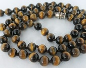 Vintage jewelry necklace in Tigers eyes beads with hand knotting and toggle clasp necklace