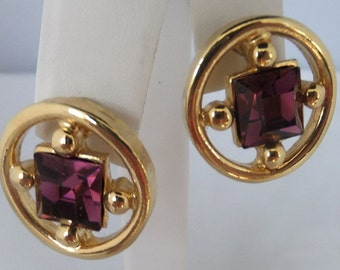 Vintage Jewelry earrings in gold tone  deep purple  Swarovski Crystal surrouned in gold tone pieced earrings Sale half off