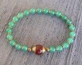 Aventurine bead mala bracelet with Tibetan capped carnelian guru bead