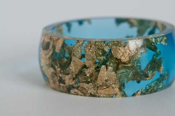 blue resin round bangle made with eco resin containing metallic gold leaf foil