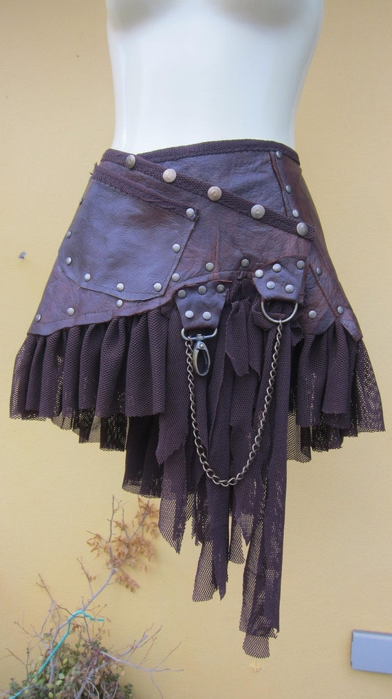 "tribal leather mini skirt belt/ with pocket,lace and stud detail....44"" to 50"" hip"