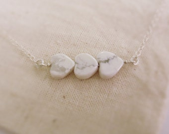 How love (necklace) - Three small howlite heart stones and sterling silver