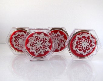 Clear Acrylic Coasters Set of 4 Crocheted Snowflake Centers Red Background