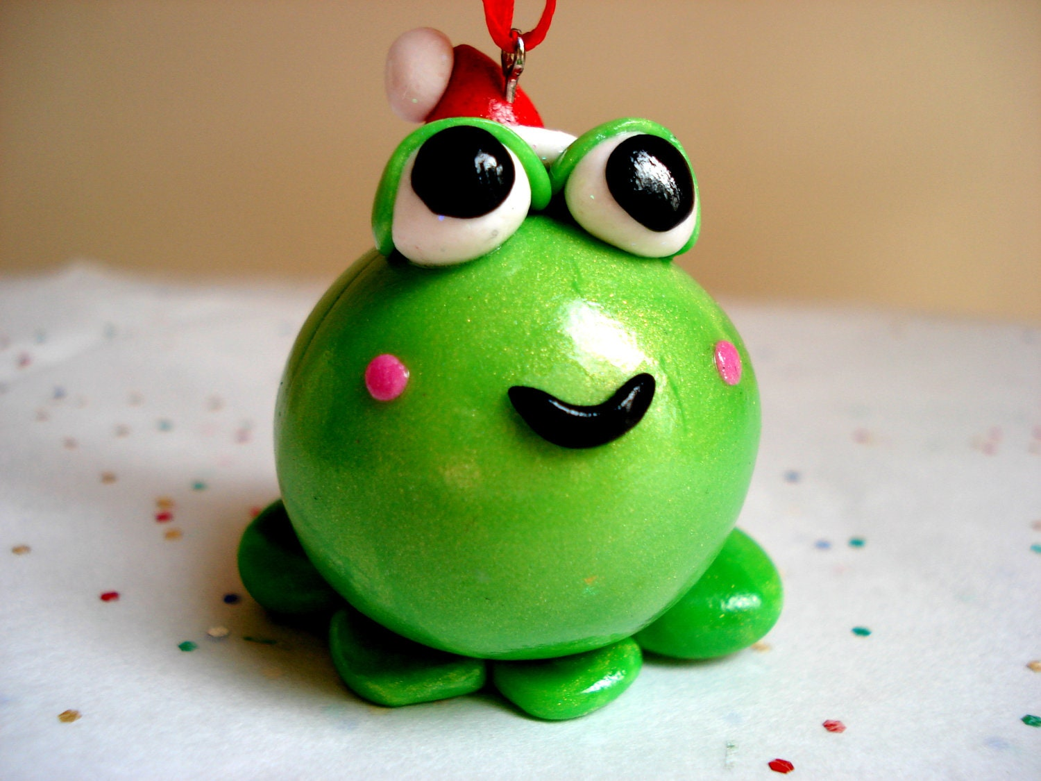 Christmas ornament frog with santa hat polymer clay