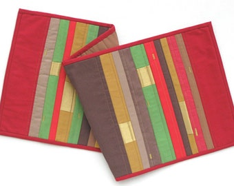 Modern patchwork table runner in stripes of red, brown and gold