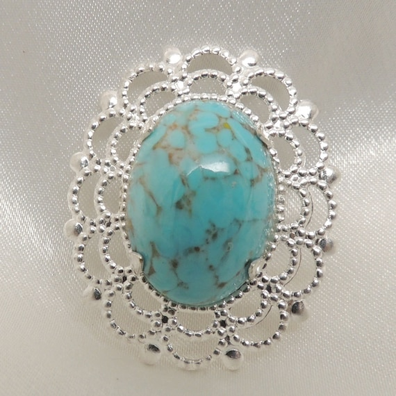 Turquoise Colored Brooch with Silver Filigree