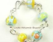 Silver Bracelet of Aqua, Orange & Yellow Lampwork Beads