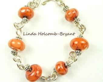 Silver Bracelet of Orange Lampwork Beads