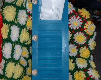 Refurbished wooden shutter with fan shell shaped knobs