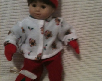 15 inch baby doll (modeled by Bitty Baby) Christmas jacket, green shirt, red pants ,hat, mittens and santa stocking
