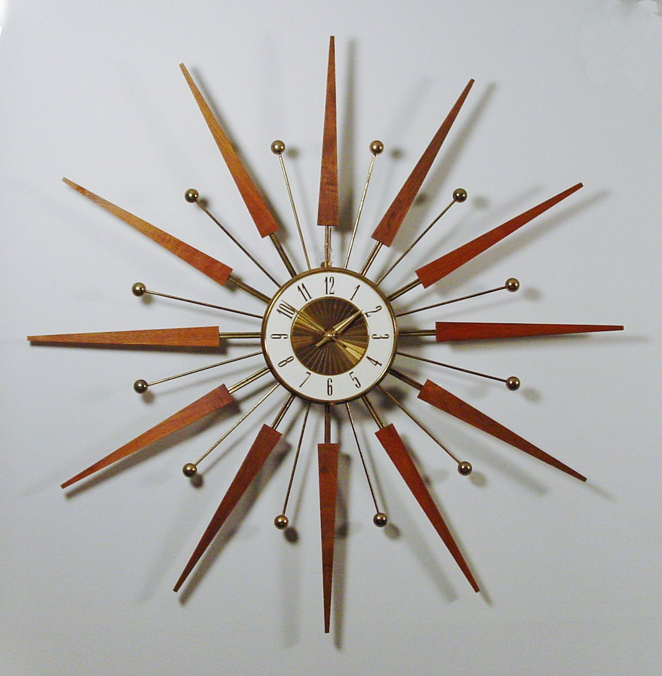 mid century modern starburst wall clock by elgin atomic. Black Bedroom Furniture Sets. Home Design Ideas