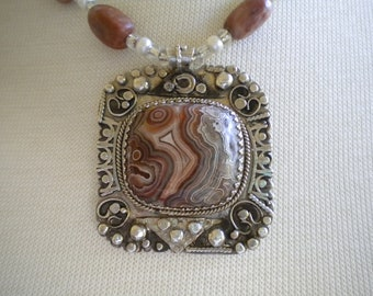 Sterling silver pendant with Mexican Crazy Lace Agate