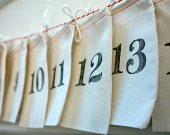 A D V E N T  C A L E N D A R made using Muslin Bags to use year after year at Christmas time stamped with vintage numbers
