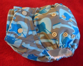 SassyCloth one size pocket diaper with blue groovy guitars  PUL print. Ready to ship.