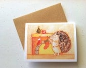 Hedgehog with Stocking Christmas Card by Megumi Lemons