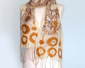 Felted  white scarf with yellow-brown  rings