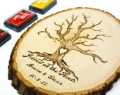 Fingerprint Tree Roots Design: Wood slice rustic theme wedding guest books. Personalized
