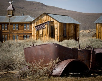 fine art print perfect wall decor of an old rusty car close to the old school in the ghost town of Bodie California