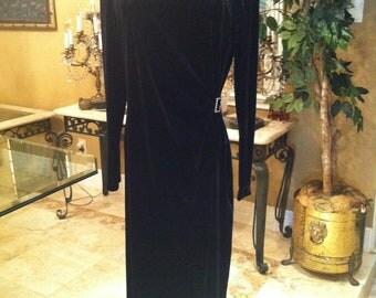 Black Velvet Longsleeve formal dress adorned with rhinestone pin on waist side