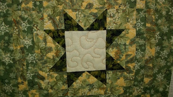 Snowflakes on Green Quilted Tabletopper Dark Green Eight Point Star