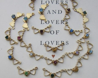 A Dozen Sweet Jeweled  Hearts With Links On Either Side