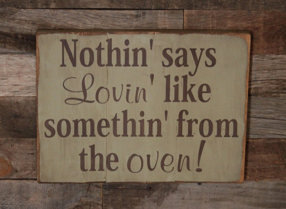 Items similar to large wood sign nothin says loving like for Kitchen quote signs