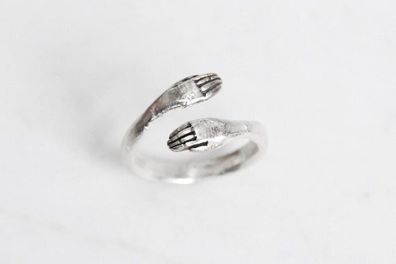Silver protective hand ring