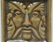 "10. ""Bracken"" greenman glazed ceramic tile. 2 1/4""sq. x 1/2"" thick."