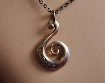 Solid Bronze Koru Pendant on antique chain or black cord