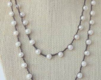 Long freshwater pearl necklace on chocolate cording