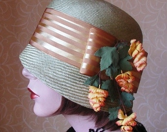 Pale green straw cloche hat.