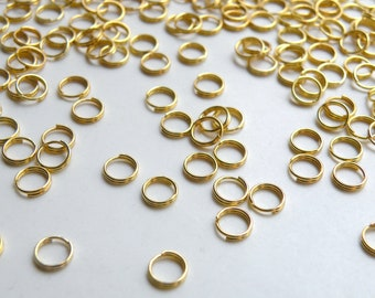 100 Split rings shiny gold plated 6mm C1756CL