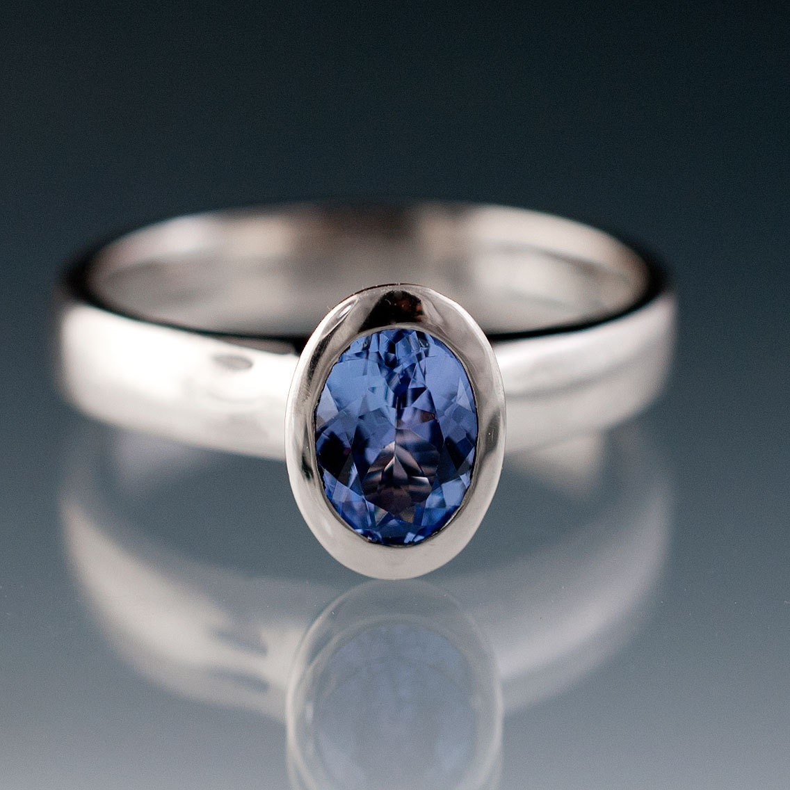 oval tanzanite bezel set ring uniue solitaire engagement ring. Black Bedroom Furniture Sets. Home Design Ideas