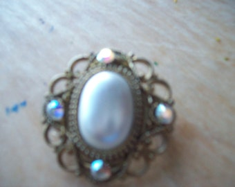 Vintage reworked Jewelry button brooch.