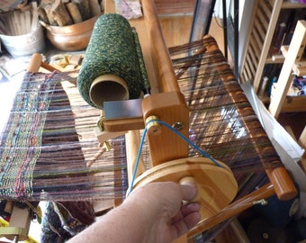 Auto Bobbin winder guide  by saori works WITH your saori looms built in bobbin winder . It automatically winds a bobbin