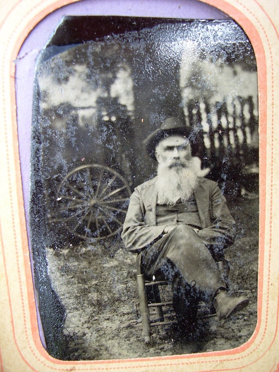 Unique Old Tintype - Bearded Man In Rocker In Yard - Fence and Wagon Wheel