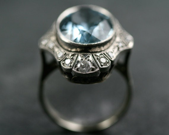 antique white gold cocktail ring with diamonds and a large aquamarine center stone