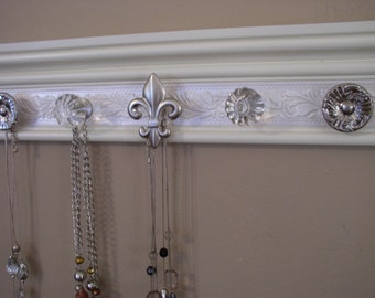 JewelryHanger. This necklace organizer has 5 knobs with embossed shimmery background on white wood base 15 inches beautiful  jewelry storage