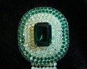 Green and clear oval rhinestone brooch with dangling stones