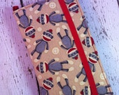 Sock Monkey print wallet for HTC Evo, Desire, Inspire, Thunder Bolt, and Droid with removable gel case