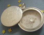 Locket with mineral glass, Sterling silver, diameter 22mm, 5mm high, design circles in a row,  with sterling silver angel