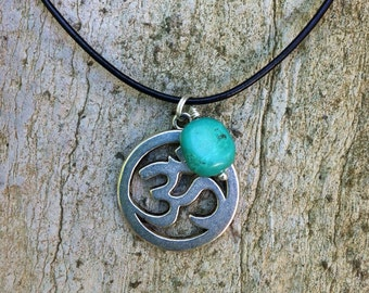 Yogi inspired OM necklace with genuine turquoise gemstone on leather cord with sterling silver clasp