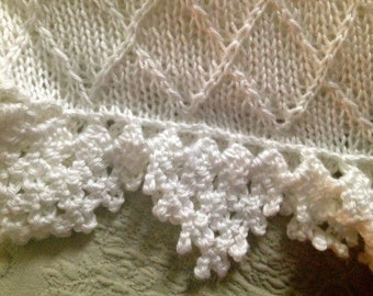 Hand knit baby blanket in diamond pattern with crocheted border.  Made to order- many colors
