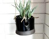 shiny black hanging pot