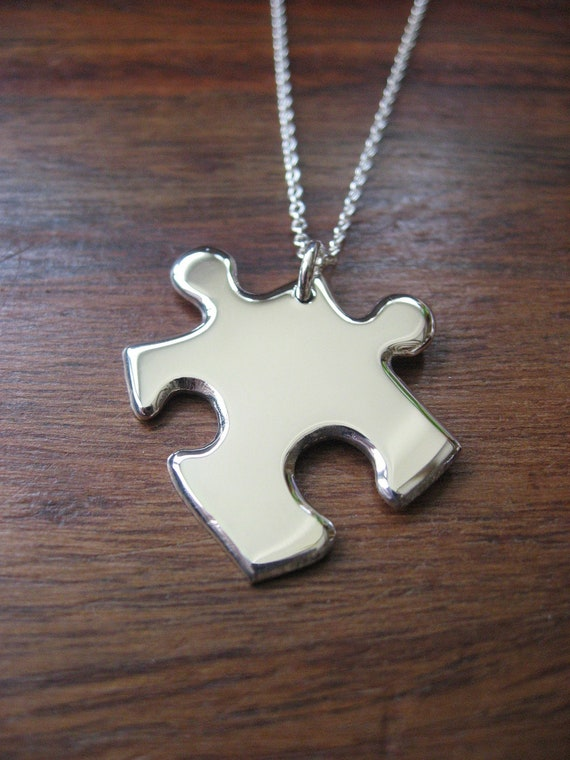 silver jigsaw puzzle pendant necklace